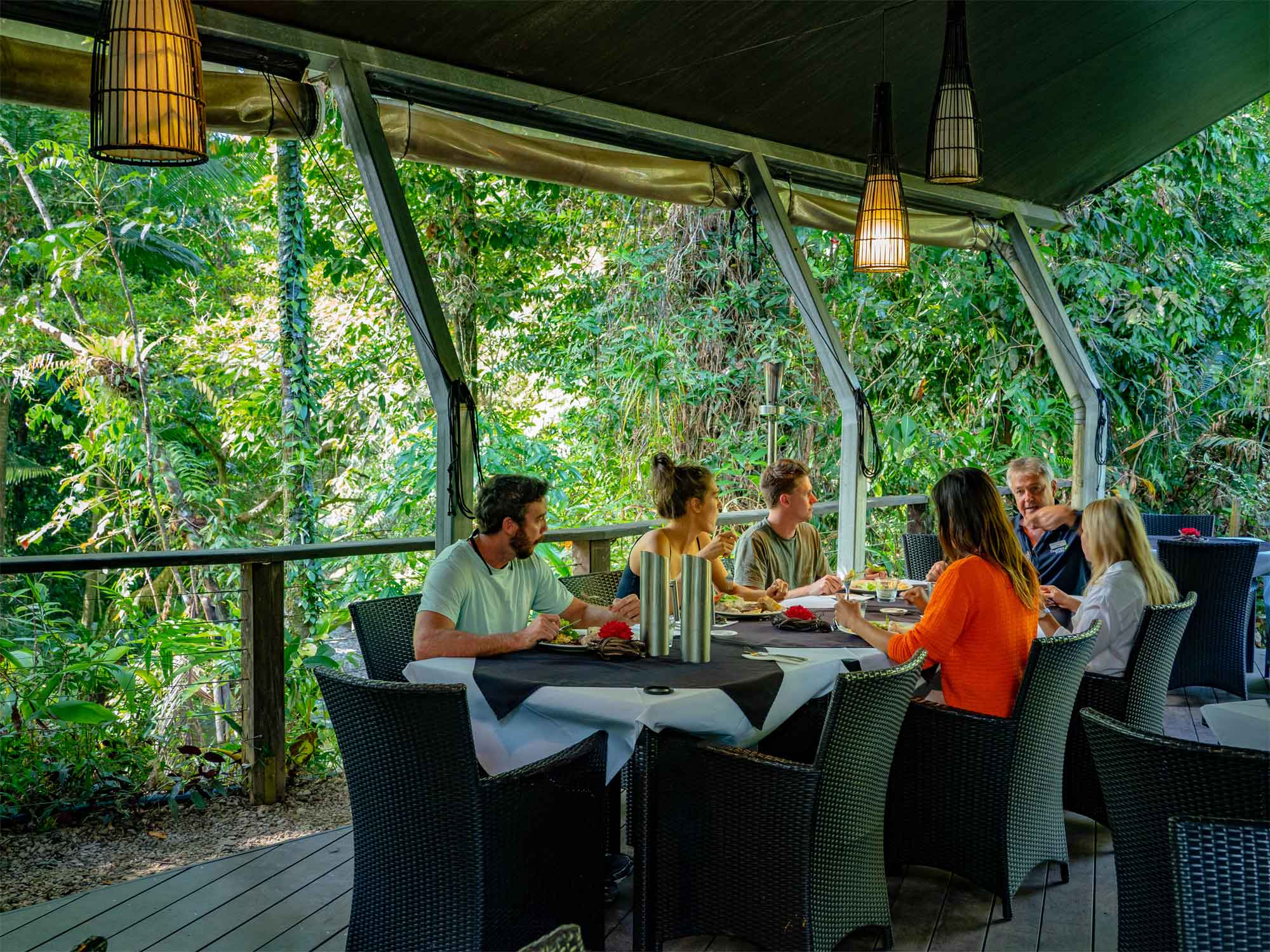 Family eating lunch at table on private tour to Daintree Rainforest